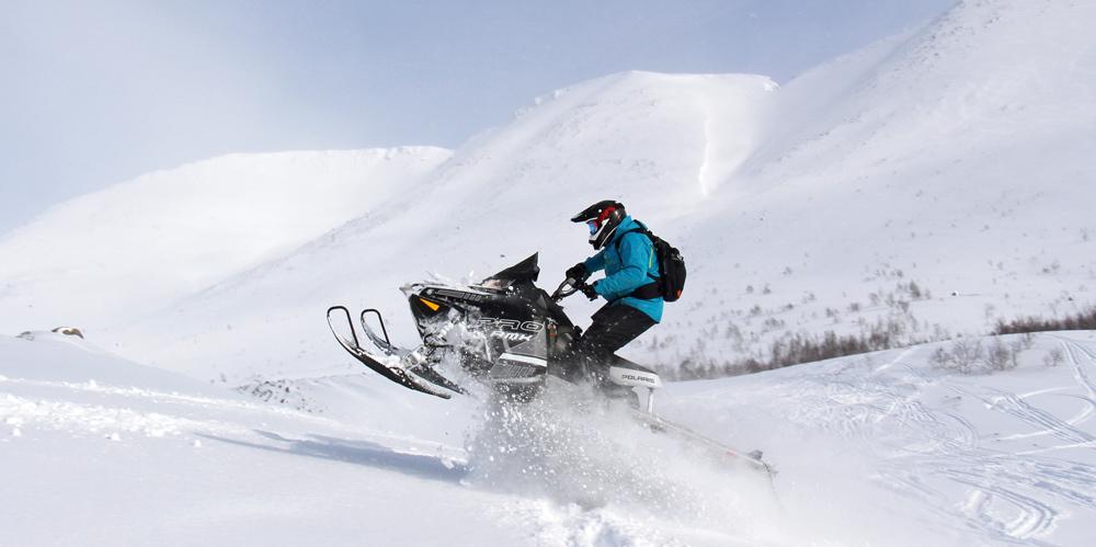 Управление снегоходом стоя